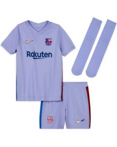 Front collective view of the Barcelona 21/22 away kit. Lilac clothing with iridescent Nike Swoosh and Barca crest. Red and navy side stripes and blue sponsor.
