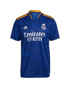 Front view of the Real Madrid 21-22 kids away shirt. Blue with light blue graffiti pattern and white/orange accents.