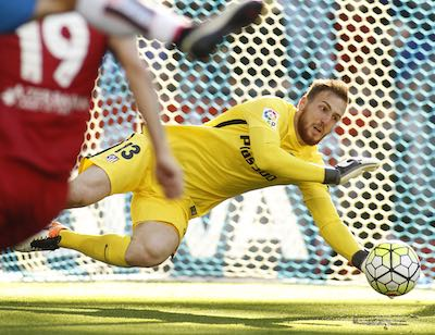 Jan Oblak making a save for Atletico Madrid